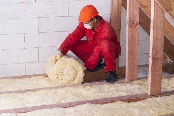 workman installing loft insulation